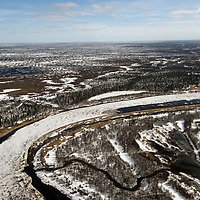 North of the Arctic Circle in Russia, a river winds through taiga forests and seemingly infinite ponds and bogs of the adjacent tundra, which is melting free of its winter snow.