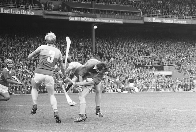 A Cork player flies over the back of a Wexford player during a tackle in the All Ireland Senior Hurling Final, Cork v Wexford in Croke Park on the 5th September 1976. Cork 2-21, Wexford 4-11.
