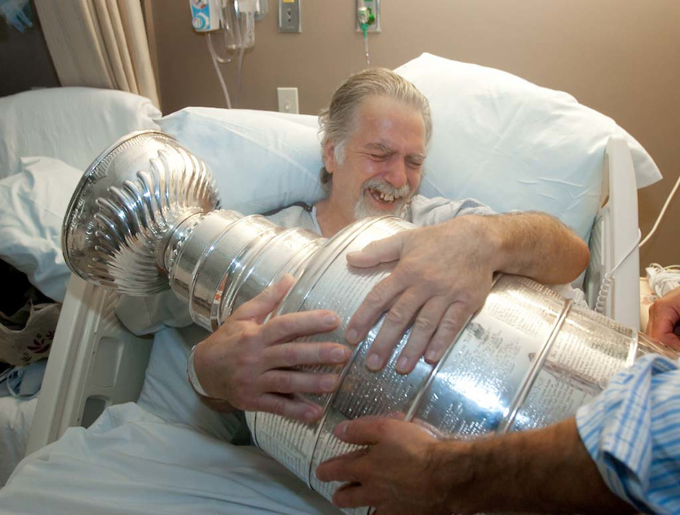 Weymouth, MA 07/11/2011.South Shore Hospital patient Bob Catyb embraces the Stanley Cup on Monday afternoon..Alex Jones / www.alexjonesphoto.com