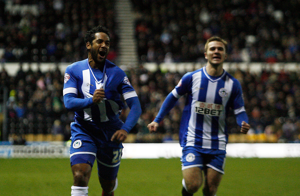 Wigan Athletic's Jean Beausejour (L) celebrates scoring his sides first goal <br /> <br /> Photo by Jack Phillips/CameraSport<br /> <br /> Football - The Football League Sky Bet Championship - Derby County v Wigan Athletic - Wednesday 1st January 2014 - The iPro Stadium - Pride Park - Derby <br /> <br /> <br /> <br /> © CameraSport - 43 Linden Ave. Countesthorpe. Leicester. England. LE8 5PG - Tel: +44 (0) 116 277 4147 - admin@camerasport.com - www.camerasport.com