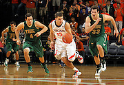 Nov. 12, 2010; Charlottesville, VA, USA;  Virginia Cavaliers guard Billy Baron (15) breaks away from William & Mary Tribe guard Matt Rum (4) and William & Mary Tribe forward JohnMark Ludwick (33) after stealing the ball during the game at the John Paul Jones Arena. Virginia won 76-52.  Photo/Andrew Shurtleff