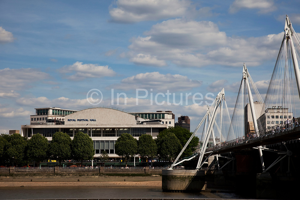 The Royal Festival Hall, part of London's Southbank arts area. The Royal Festival Hall is a 2,900 seat concert venue within Southbank Centre in London. It is situated on the South Bank of the River Thames, not far from Hungerford / Golden Jubilee Bridge. Opened in 1951, it is a Grade I listed building.