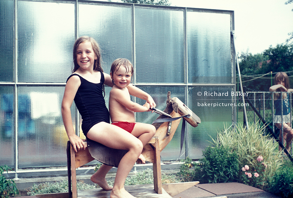 Children pose for a photo at a swimming pool in Germany, on 13th July 1970, in Bielefeld, Germany.