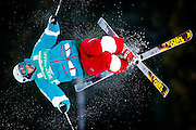 USA's Jeremy Cota makes a twisting jump during the qualifying round in the men's World Cup freestyle skiing moguls event at the Deer Valley Resort, Jan. 14, 2010, in Park City, Utah.  (AP Photo/Colin E Braley)..