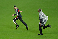 French young man is running over the playground during the first half time followed by the security man during the FIFA Friendly Game football match between France and Republic of Ireland on May 28, 2018 at Stade de France in Saint-Denis near Paris, France - Photo Stephane Allaman / ProSportsImages / DPPI