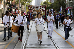 September 4, 2017 - Toronto, ON, Canada - TORONTO, ON - SEPTEMBER 4  - A percussion band marches along Queen St. W. during the annual Toronto Labour day parade, September 4, 2017. Andrew Francis Wallace/Toronto Star (Credit Image: © Andrew Francis Wallace/The Toronto Star via ZUMA Wire)