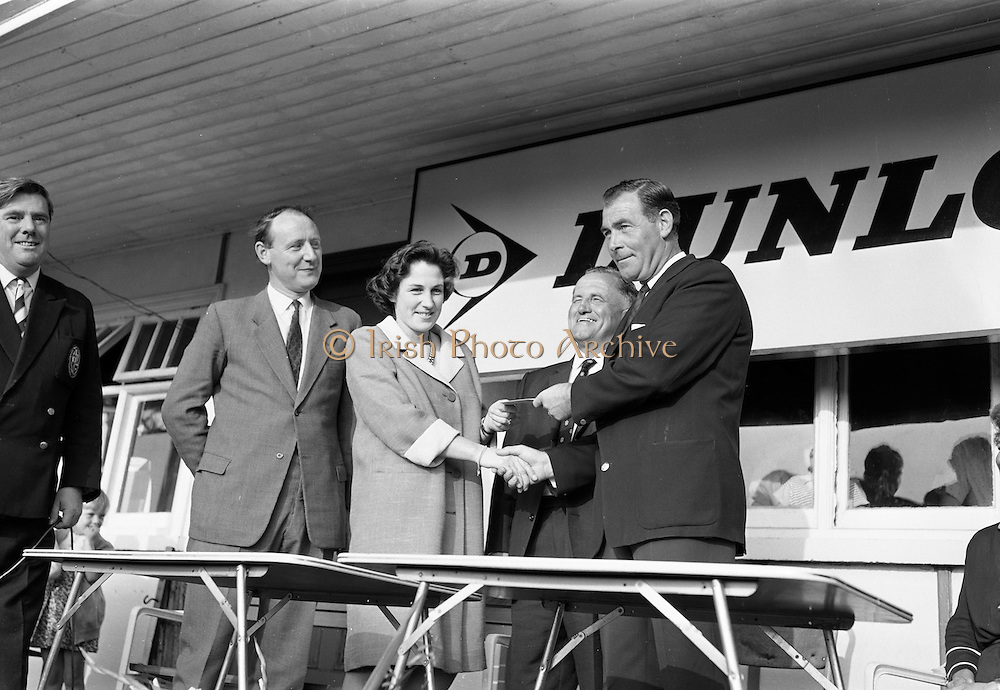 Christy O'Connor (right) receiving the first prize from Mrs John Sheridan, wife of the Marketing Director of the Irish Dunlop Co., with Dr. R.F. O'Driscoll, (second from right), Captain Tramore Golf Club and Mr. John Sheridan at the Irish Dunlop £1,000 Tournament at Tramore Golf Club, Co. Waterford on the 20th August 1967.