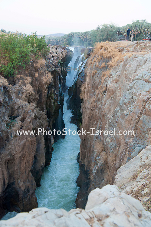 River rushing over jagged cliffs, Epupa falls Cunene River in Namibia on the border with Angola
