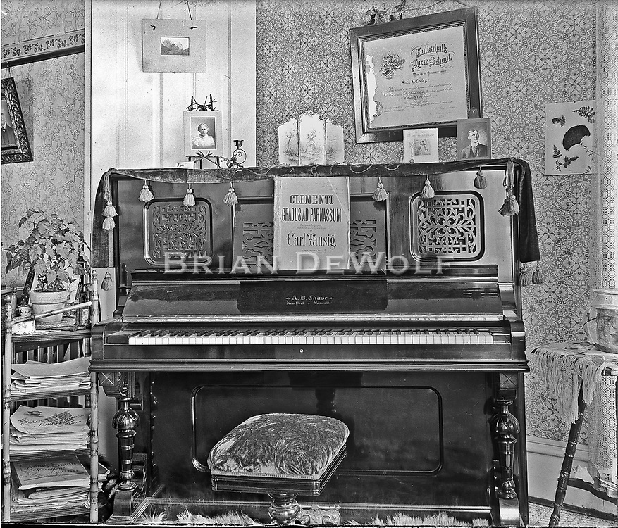 Inside the Cooley home (corner of Spring & College Streets). The certificate above the piano is from the Gottschalk Lyric School in Chicago naming Sam L. Cooley.