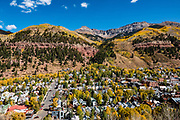 Admire the San Juan Mountains and yellow fall foliage colors from Telluride's FREE Gondola in Colorado, USA. Opened in November 1996, the Telluride/Mountain Village Gondola covers 3 miles in 13 minutes, and saves 8 miles of driving.