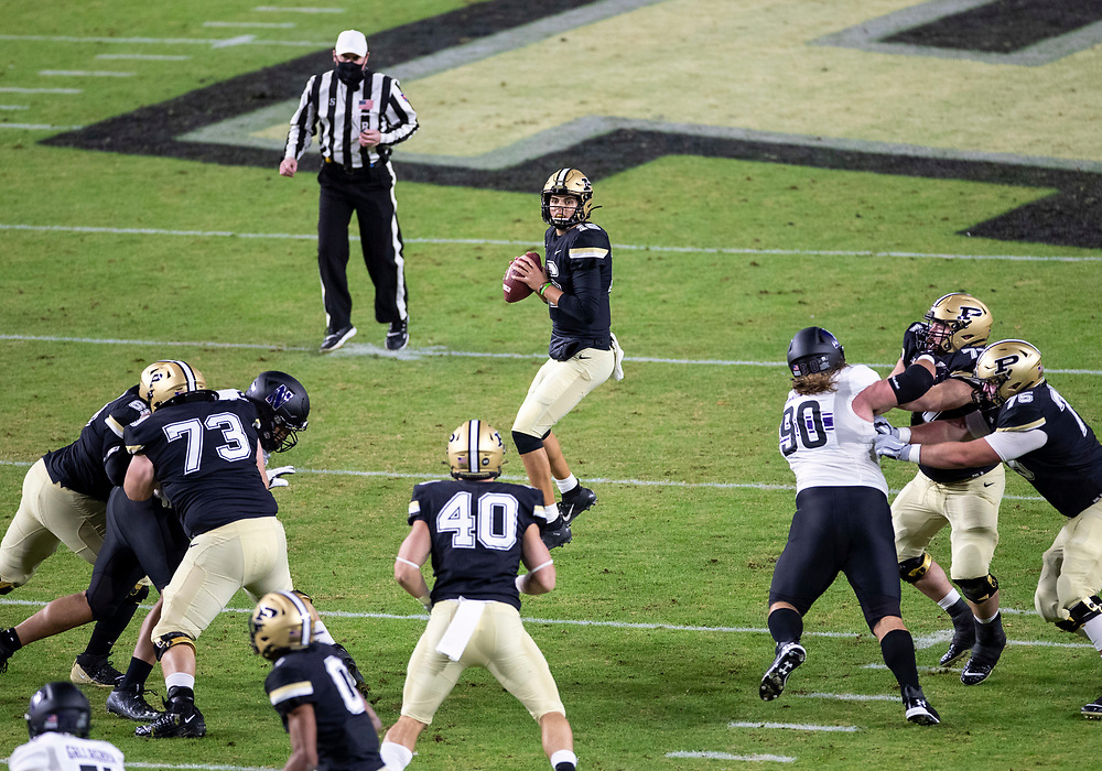 November 14, 2020:  Purdue quarterback Aidan O'Connell (16) sets in the pocket during NCAA football game action between the Northwestern Wildcats and the Purdue Boilermakers at Ross-Ade Stadium in West Lafayette, Indiana. Northwestern defeated Purdue 27-20.  John Mersits/CSM.