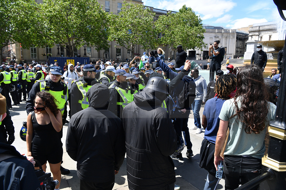 © Licensed to London News Pictures. 13/06/2020. London, UK. Protesters take part in a demonstration in central London organised by Black Lives Matter clash with the far righr in Trafalgar Square.<br /> . The Metropolitan Police has placed restrictions ahead of the march in order to avoid serious disorder as far-right groups are also demonstrating. Photo credit: Ray Tang/LNP