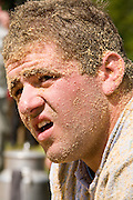 29 JULY 2007 -- BRUNIG, OBWALDNER, SWITZERLAND: Men who lost their match, their faces covered in sawdust at the Brunig Schwinget, a wrestling tournament in Brunig, in the canton of Obwaldner, Switzerland. Schwingets are Swiss style wrestling tournaments held throughout Switzerland. They are usually held outdoors in Alpine mountain passes. Wrestlers wear special canvas pants over their regular clothes. They grip each others pants and wrestle on bed of sawdust. The Schwinget in Brunig is one of the most popular in Switzerland with over 6,000 spectators and more than 120 wrestlers. There is Swiss Alpenhorn blowing, flag throwing and yodeling at the Schwinget.  Photo by Jack Kurtz