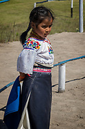 A young Kichwa girl at the Kapak Raymi cerebration, with crumbs around her mouth.