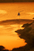 7 May 2009 - Santa Barbara, CA -Water dropping helicopter uses a local reservoir to fill it's tanks as fire crews work to extinguish  Jesusita wildfire hot spots fires in the foothills of in Santa Barbara, California.  Photo Credit: Rod Rolle/Sipa Press,  21 August 2009-Santa Barbara, CA: