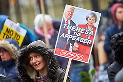 © Licensed to London News Pictures. 04/02/2017. LONDON, UK.  Thousands of protesters walk through central London calling for an end to a travel ban on muslims imposed US president Trump and for his state visit invitation to be withdrawn. The march started outside the US embassy and finished in Whitehall, opposite Downing Street.  Photo credit: Cliff Hide/LNP