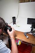 Researcher documenting Praying Mantis in the Manu learning centre, Manu National Park, Peru, South America