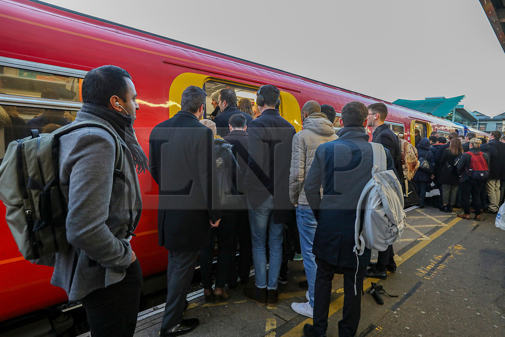 © Licensed to London News Pictures. 02/12/2019. London, UK. Commuters queue on platforms on the first day of the South Western Railway strike at Clapham Junction. RMT union have announced industrial action which will effect South Western Railway services for the next 27 days, until 02 January 2020. Photo credit: Alex Lentati/LNP