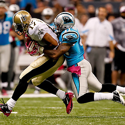 October 3, 2010; New Orleans, LA, USA; New Orleans Saints wide receiver Robert Meachem (17) is tackled by Carolina Panthers cornerback Captain Munnerlyn (41) during the second half at the Louisiana Superdome. The Saints defeated the Panthers 16-14. Mandatory Credit: Derick E. Hingle