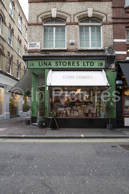 Exterior of Italian delicatessen, Lina Stores, on 19th October 2015 in London, United Kingdom. Family-run Italian deli serving homemade pasta, cheese, cured meats, groceries and fresh coffee in the heart of Soho.