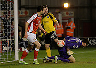 Walsall goalkeeper Richard O'Donnell is fouled by Jason Holt during the Sky Bet League 1 match between Walsall and Sheffield Utd at the Banks's Stadium, Walsall, England on 17 March 2015. Photo by Alan Franklin.