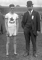 H525<br /> Tailteann Games: Athletes Games. An athlete from Canada with a referee. 1924. (Part of the Independent Newspapers Ireland/NLI Collection)