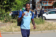 AFC Wimbledon attacker Michael Folivi (17) arriving and holding up a lottery ticket during the EFL Sky Bet League 1 match between AFC Wimbledon and Shrewsbury Town at the Cherry Red Records Stadium, Kingston, England on 14 September 2019.