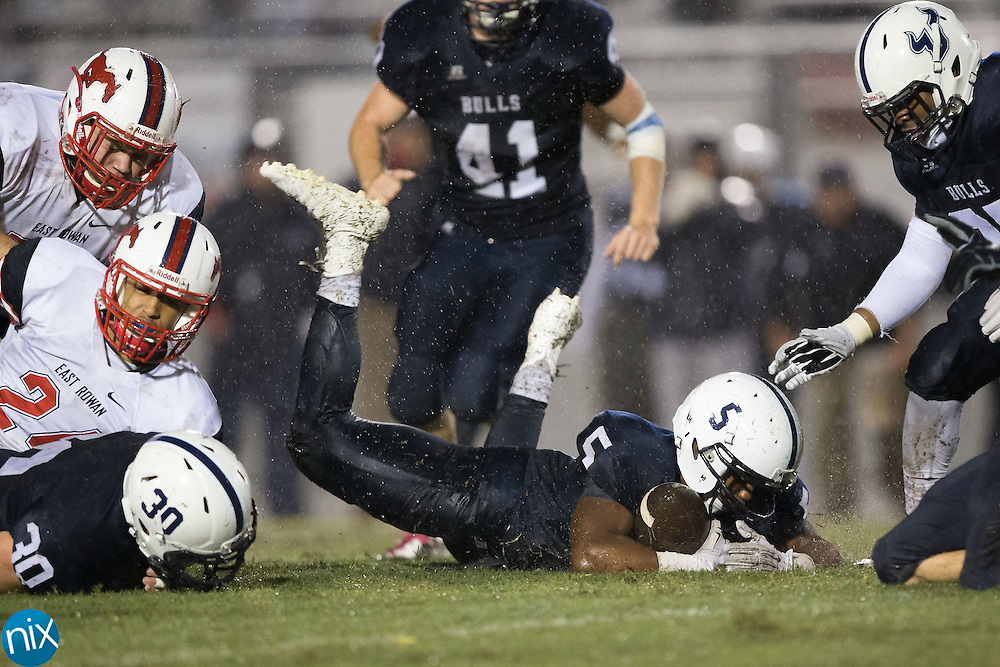 Carter Edwards (5) of the Hickory Ridge Ragin' Bulls recovers a fumble during second half action against the East Rowan Mustangs at Hickory Ridge High School on October 2, 2015 in Harrisburg, North Carolina.  The Ragin' Bulls defeated the Mustangs 20-7.  (Brian Westerholt/Special to the Tribune)
