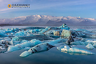 Calving icebergs in Jokulsarlon Glacier Lagoon in south Icleand
