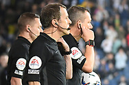 The match officials enter the pitch during the EFL Sky Bet Championship match between West Bromwich Albion and Derby County at The Hawthorns, West Bromwich, England on 14 September 2021.