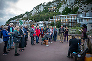Locals gathered on Dover seafront for a candlelit vigil to mark the tragic death of a 27 year old Eritrean man who sadly fell from an overcrowd boat in the English channel, the event was held on the 19th of August 2021 in Dover, United Kingdom. Locals came together to honour the memory of lives lost and to once again, urgently call on the British government to put an end to these needless deaths and to act by implementing safe and legal routes to asylum in the UK.