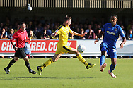 AFC Wimbledon midfielder Liam Trotter (14) passing the ball during the EFL Sky Bet League 1 match between AFC Wimbledon and Oxford United at the Cherry Red Records Stadium, Kingston, England on 29 September 2018.
