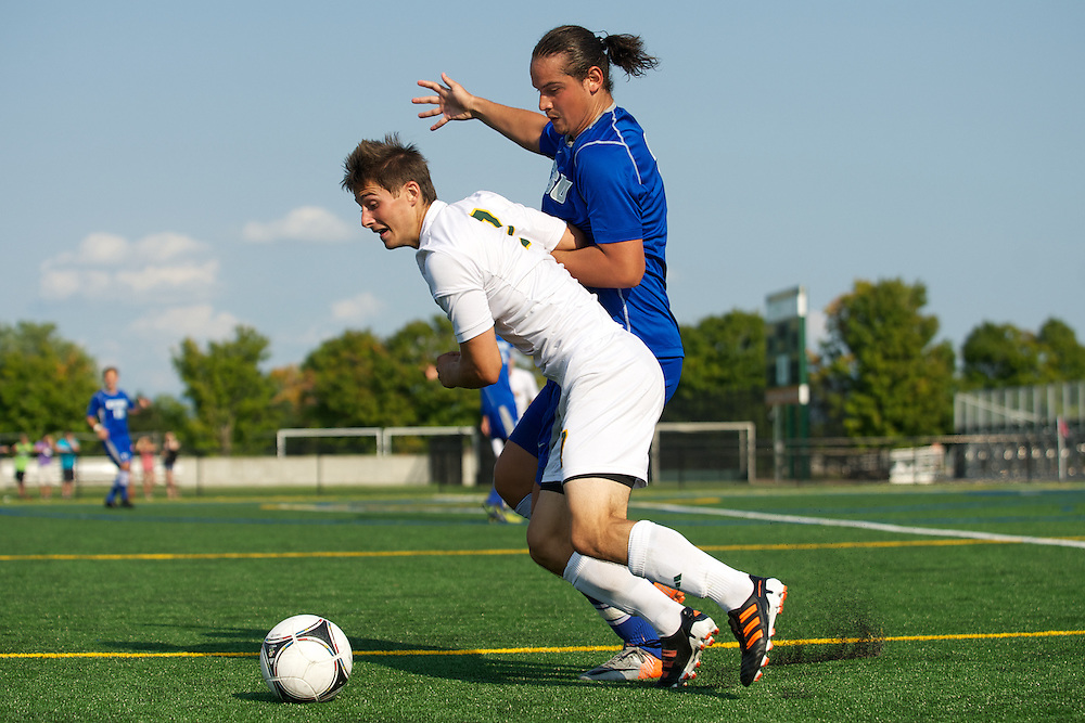 Catamounts forward Jesse Scheirer (7) battles for the ball during the men's soccer game between the Central Connecticut State University Blue Devils and the Vermont Catamounts at Virtue Field on Friday afternoon September 7, 2012 in Burlington, Vermont.