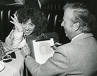 1978 Artist, Jack Lane, sketches June Gable for the Brown Derby Restaurant's Caricature of Fame Wall.
