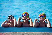 Bathing belles pose in the pool at Tooting Bec Lido, Tooting, London, UK<br /> Tooting Bec Lido is the largest open-air swimming pool in London. Opened in 1906 it is still popular and used throughout the year by swimmers.