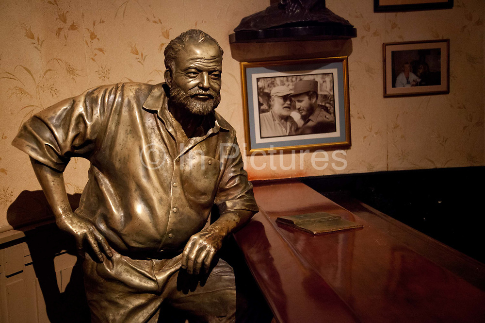Sculpture of Ernest Hemingway leaning against the bar in the Floridita, Havana's most famous bar and Hemingway's favourite spot.