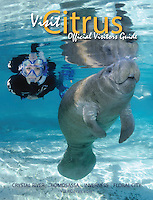 My third cover for Visit Citrus Magazine. A younger female manatee catches a breath as my friend Meredith admires her in the crystal clear waters of Three Sisters Spring, Crystal River, Florida.<br />