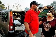 From left: Walter Batt and Jessica Banda load their car and evacuate their home near Red Winery Road and Pine Flat Road during the Kincade Fire on Friday, Oct. 25, 2019, in an unincorporated area just outside Geyserville, Calif.