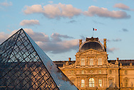 The sun sets on the Musée du Louvre in Paris on May 16, 2012.