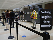 Voters line up for the start of early voting.