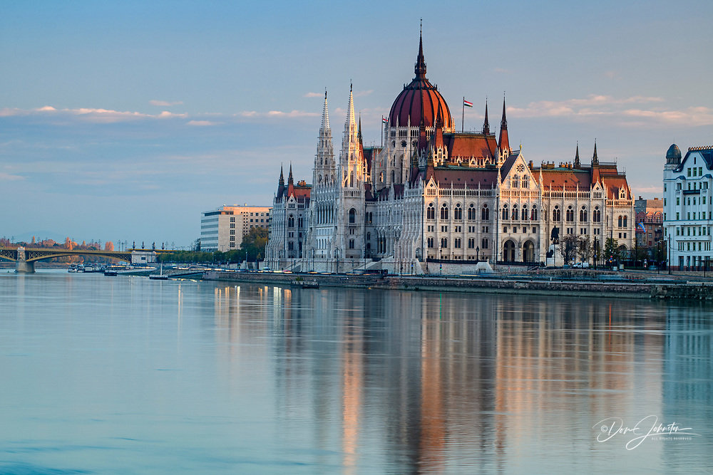 Hungarian Parliament buildings reflected in the Danube at dawn, Budapest, Central Hungary, Hungary