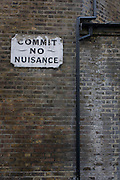A Victorian-era 'Commit No Nuisance' sign on the wall of a south London church premises.