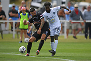 Auckland City FC's Mohamed Awad takes a shot past Hawke's Bay United's Jim Hoyle in the Handa Premiership football match, Hawke's Bay United v Auckland City FC, Bluewater Stadium, Napier, Sunday, January 31, 2021. Copyright photo: Kerry Marshall / www.photosport.nz