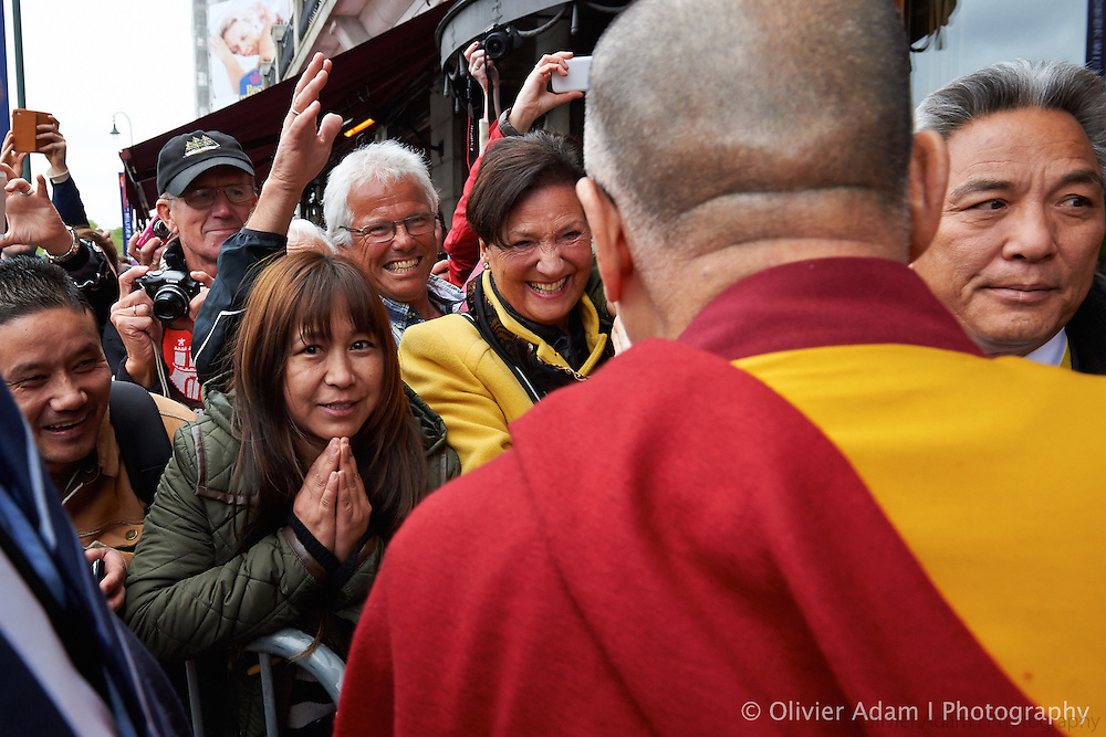 Some People are welcoming His Holiness on His way back to Grand Hotel. Dalai Lama