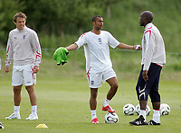 Photo: Paul Thomas.<br /> England Training Session. 01/06/2006.<br /> <br /> Ashley Cole (C) has words to Sol Campbell over a training drill, while Phil Neville (L) looks on