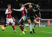 Football - 2020 / 2021 Premier League - Arsenal vs Manchester United - Emirates Stadium<br /> <br /> Nicolas Pepe of Arsenal and Harry Maguire of United<br /> <br /> COLORSPORT/ANDREW COWIE