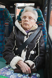 Elderly woman with Cerebral Palsy in specialised transport  for people with physical and sensory impairment.