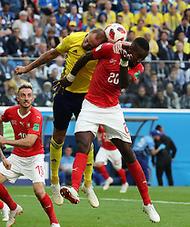 SAINT PETERSBURG, July 3, 2018  Johan Djourou (R) of Switzerland competes for a header with Andreas Granqvist of Sweden during the 2018 FIFA World Cup round of 16 match between Switzerland and Sweden in Saint Petersburg, Russia, July 3, 2018. Sweden won 1-0 and advanced to the quarter-final. (Credit Image: © Yang Lei/Xinhua via ZUMA Wire)
