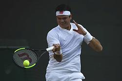 JOHN ISNER BEATS MILOS RAONIC AT WIMBLEDON CHAMPIONSHIPS 2018.(180711) -- LONDON, July 11, 2018  Milos Raonic of Canada hits a return during the men's singles quarter-final match against John Isner of The United States at the Wimbledon Championships 2018 in London, Britain, on July 11, 2018. John Isner won 3-1. (Credit Image: © Stephen Chung/Xinhua via ZUMA Wire)