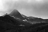 Storm clouds begin rolling over Pyramid Peak in North Cascades National Park, Washington State, USA